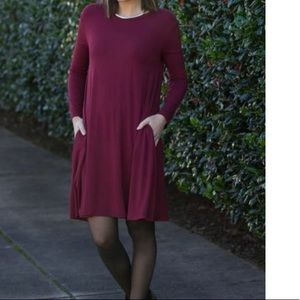 Burgundy Swing Dress with seamless pockets.